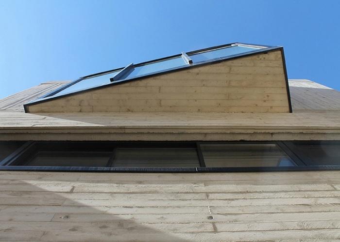 Maison de ville en béton : Détail bow window en béton